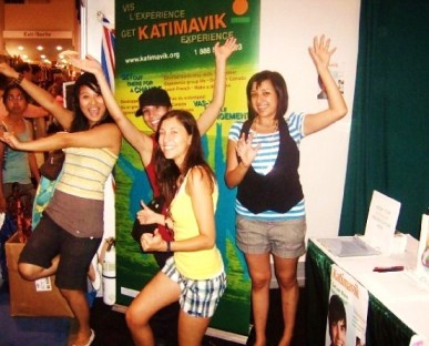 Some friends pass by the Katimavik promo-booth I ran last summer at the CNE